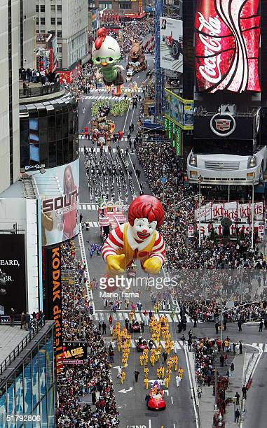 Ronald McDonald and Chicken Little balloons float down Broadway during the 78th Annual Macy's Thanksgiving Day Parade November 25 2004 in New York...