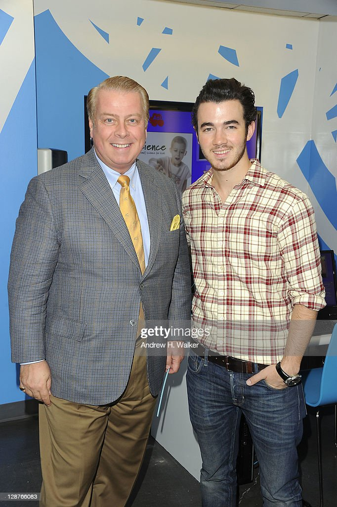 Ronald McDonald House CEO Bill Sullivan and <a gi-track='captionPersonalityLinkClicked' href=/galleries/search?phrase=Kevin+Jonas&family=editorial&specificpeople=709547 ng-click='$event.stopPropagation()'>Kevin Jonas</a> attend the unveiling of the AOL media room at the Roanld McDonald House on October 7, 2001 in New York City.