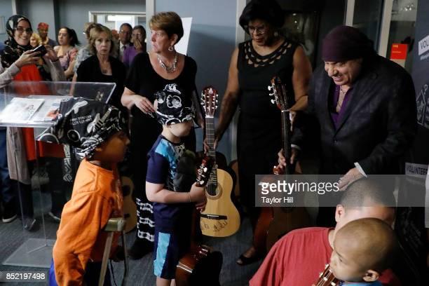 Ronald McDonald House Founding Ambassador Steven Van Zandt poses with pediatric cancer patients after donating bandanas and 95 guitars at the...