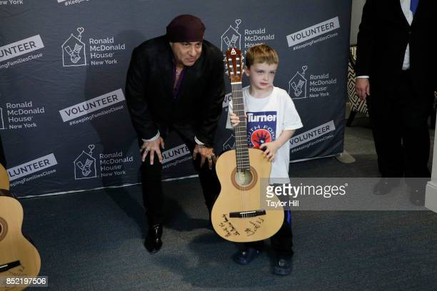 Ronald McDonald House Founding Ambassador Steven Van Zandt poses with pediatric cancer patients after donating 95 guitars at the newlyreopened Ronald...