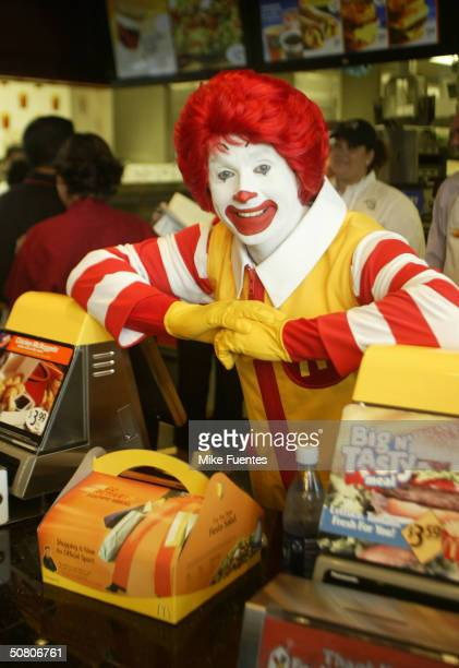 Ronald McDonald smiles with a Happy Meal for adults at a McDonald's restaurant on Thursday May 6 2004 May 6 2004 in Dallas Texas The meal which...