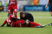 Ronald Mukilbi of Ostersunds FK injured during the Allsvenskan match between Ostersunds FK and Malmo FF at Jamtkraft Arena on May 28 2016 in...