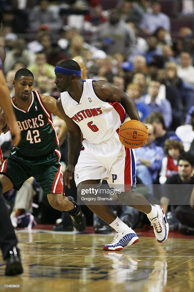 Ronald Murray #6 of the Detroit Pistons dribbles against Charlie Bell #42 of the Milwaukee Bucks on November 1, 2006 at the Palace of Auburn Hills in Auburn Hills, Michigan. Milwaukee won the game 105-97.