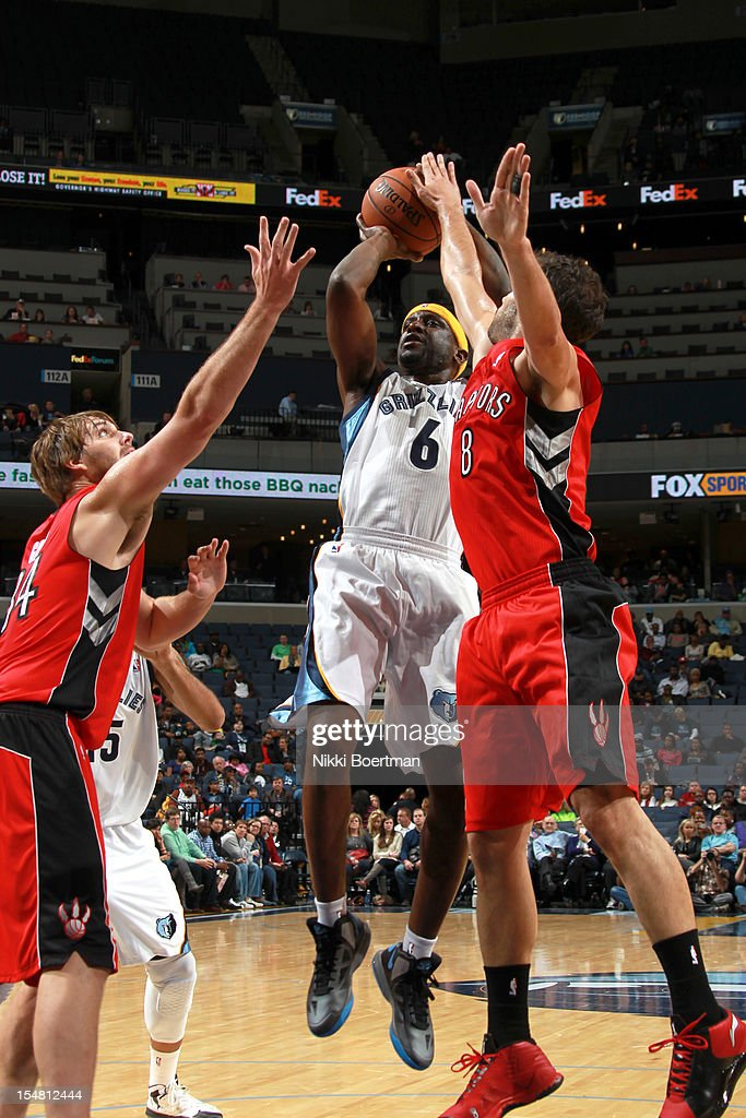 <a gi-track='captionPersonalityLinkClicked' href=/galleries/search?phrase=Ronald+Murray&family=editorial&specificpeople=202899 ng-click='$event.stopPropagation()'>Ronald Murray</a> #6 of the Memphis Grizzlies shoots between <a gi-track='captionPersonalityLinkClicked' href=/galleries/search?phrase=Aaron+Gray+-+Basketball+Player&family=editorial&specificpeople=666453 ng-click='$event.stopPropagation()'>Aaron Gray</a> #34 and Jose Calderon #8 of the Toronto Raptors on October 26, 2012 at FedExForum in Memphis, Tennessee.