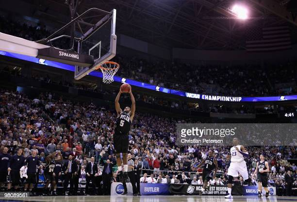 Ronald Nored of the Butler Bulldogs drives to the basket against the Kansas State Wildcats in the final moments of the west regional final of the...