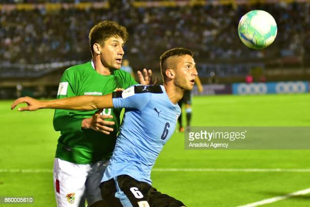 Ronald Raldes and Uruguay's Rodrigo Bentancur vie for the ball during the 2018 FIFA World Cup Qualification match between Uruguay and Bolivia at...