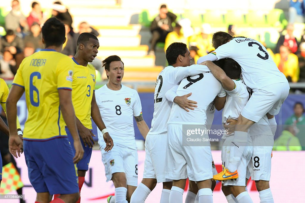 Ronald Raldes of Bolivia celebrates with teammates after scoring the opening goal during the 2015 Copa America Chile Group A match between Ecuador...