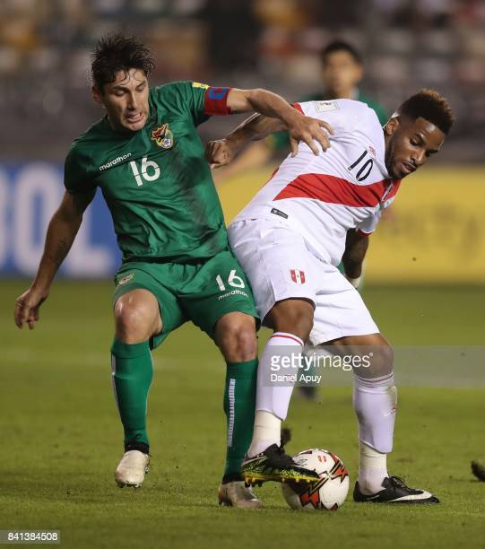 Ronald Raldes of Bolivia fight for the ball with Jefferson Farfan of Peru during a match between Peru and Bolivia as part of FIFA 2018 World Cup...