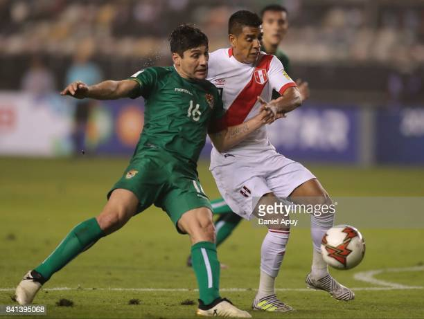 Ronald Raldes of Bolivia fights for the ball with Paolo Hurtado of Peru during a match between Peru and Bolivia as part of FIFA 2018 World Cup...