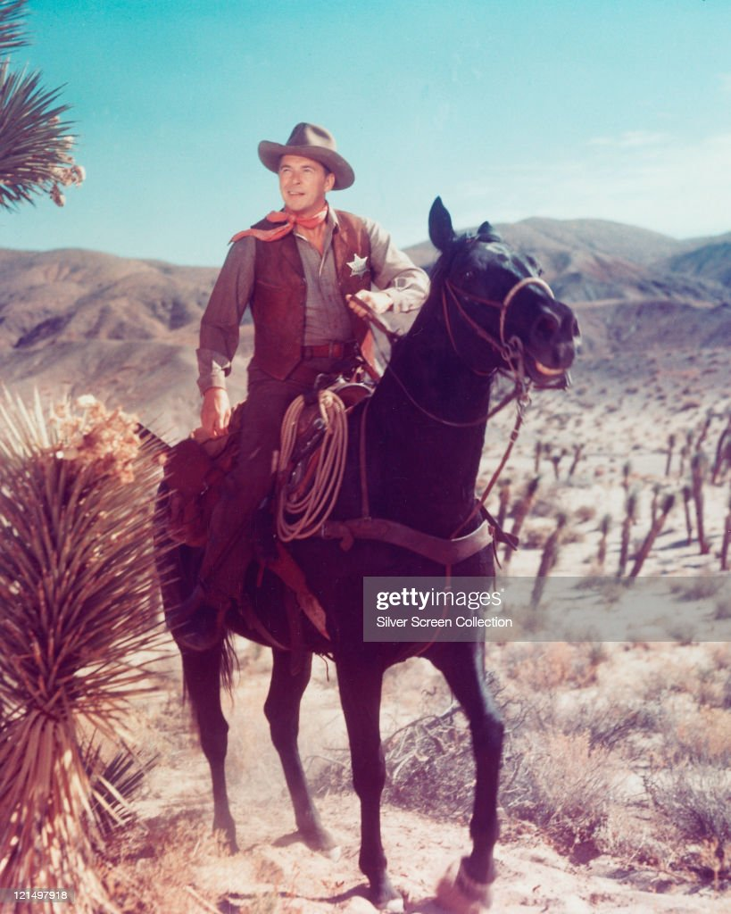 Ronald Reagan US actor in costume and on horseback in a publicity still issued for the film 'Law and Order' 1953 The Western directed by Nathan Juran...