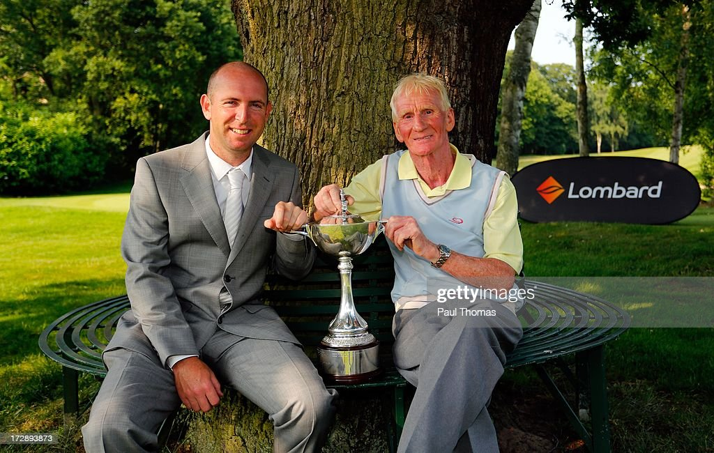 Ronald Singleton (R) and Chris Crowder of Lee Park Golf Club pose with the trophy after the Lombard Trophy PGA National Pro-Am Championship Regional Final at Dunham Forest Golf and Country Golf Club on July 5, 2013 in Manchester, England.