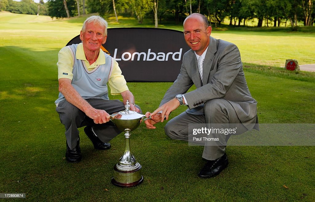 Ronald Singleton (L) and Chris Crowder of Lee Park Golf Club pose with the trophy after the Lombard Trophy PGA National Pro-Am Championship Regional Final at Dunham Forest Golf and Country Golf Club on July 5, 2013 in Manchester, England.