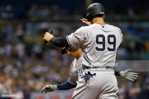 Ronald Torreyes and Aaron Judge of the New York Yankees celebrate at the plate after scoring off of Torreyes' tworun home run during the third inning...