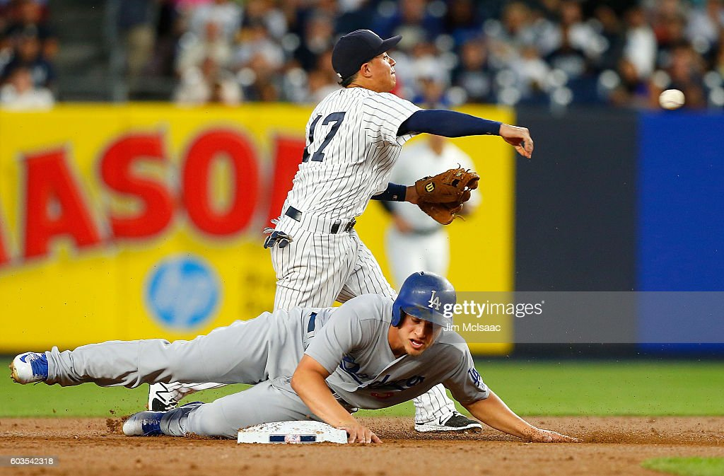 Ronald Torreyes #17 of the New York Yankees attempts a first inning double play after forcing out Corey Seager #5 of the Los Angeles Dodgers at Yankee Stadium on September 12, 2016 in the Bronx borough of New York City.