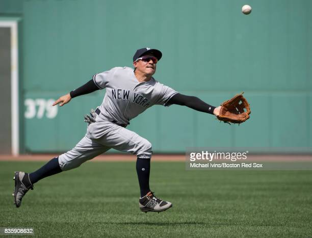 Ronald Torreyes of the New York Yankees attempts to catch a single hit by Xander Bogaerts of the Boston Red Sox in the second inning at Fenway Park...
