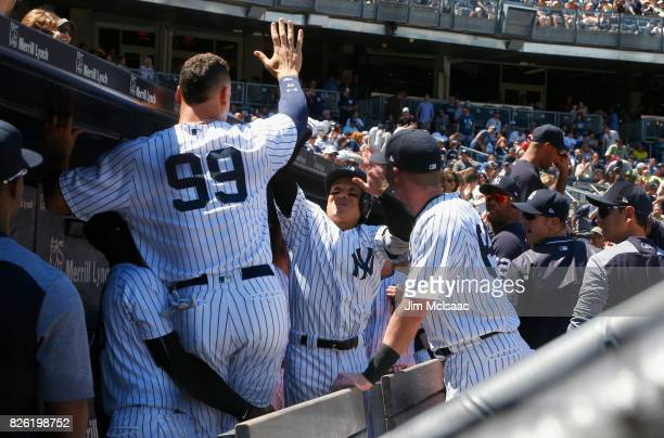 Ronald Torreyes of the New York Yankees celebrates his second inning two run home run against the Tampa Bay Rays with teammate Aaron Judge at Yankee...