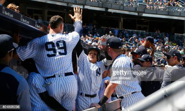Ronald Torreyes of the New York Yankees celebrtes his second inning two run home run against the Tampa Bay Rays with teammate Aaron Judge at Yankee...