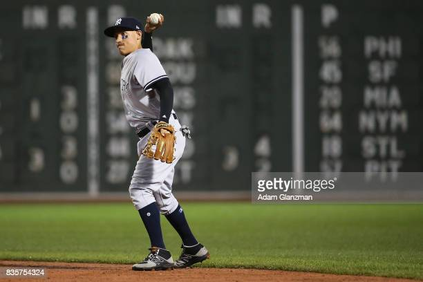 Ronald Torreyes of the New York Yankees fields a ground ball in the fourth inning of a game against the Boston Red Sox at Fenway Park on August 18...