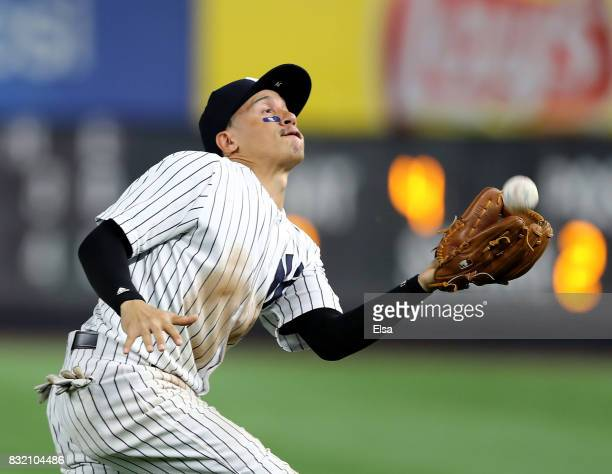 Ronald Torreyes of the New York Yankees fields a hit by Wilmer Flores of the New York Mets in the fourth inning during interleague play on August 15...