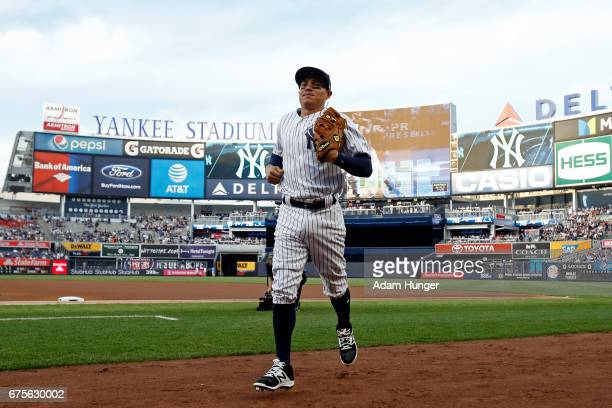 Ronald Torreyes of the New York Yankees heads the the dugout against the Baltimore Orioles at Yankee Stadium on April 28 2017 in the Bronx borough of...