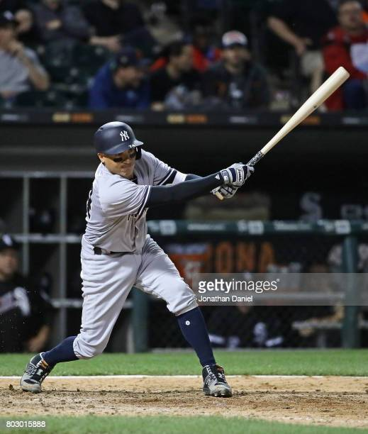 Ronald Torreyes of the New York Yankees hits a run scoring double in the 6th inning against the Chicago White Sox at Guaranteed Rate Field on June 28...
