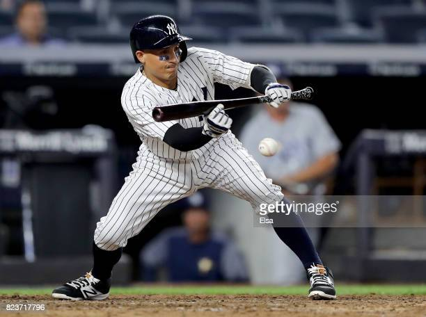 Ronald Torreyes of the New York Yankees hits a sacrifice bunt in the 10th inning against the Tampa Bay Rays on July 27 2017 at Yankee Stadium in the...