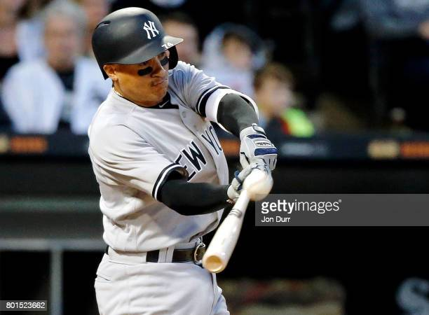 Ronald Torreyes of the New York Yankees hits a sacrifice fly against the Chicago White Sox during the fourth inning to score Gary Sanchez at...