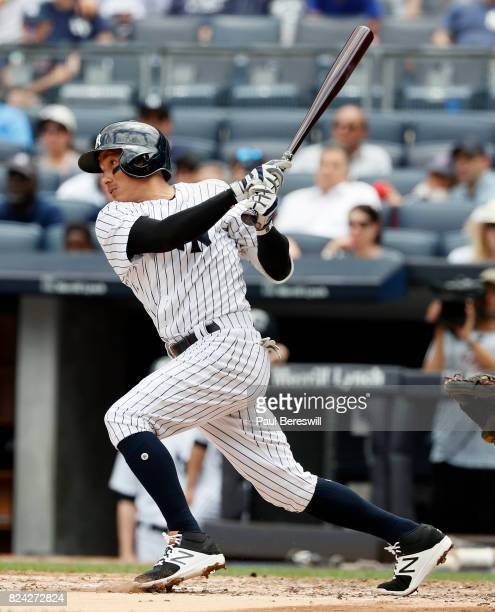 Ronald Torreyes of the New York Yankees hits a single in an interleague MLB baseball game against the Cincinnati Reds on July 26 2017 at Yankee...