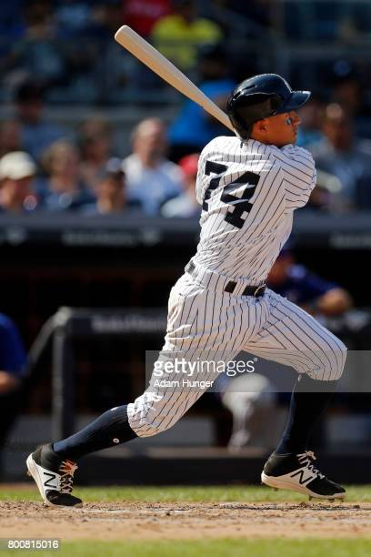 Ronald Torreyes of the New York Yankees hits a solo home run against the Texas Rangers during the seventh inning at Yankee Stadium on June 25 2017 in...