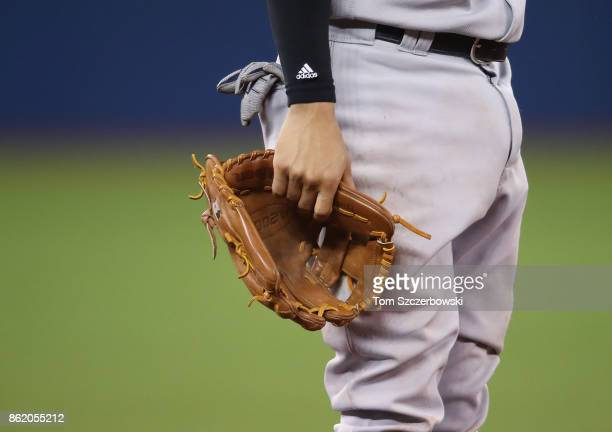 Ronald Torreyes of the New York Yankees holds his glove by his side during MLB game action against the Toronto Blue Jays at Rogers Centre on August 9...