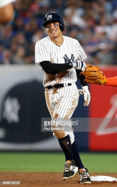 Ronald Torreyes of the New York Yankees laughs as he is safe at second base with a double in an interleague MLB baseball game against the New York...