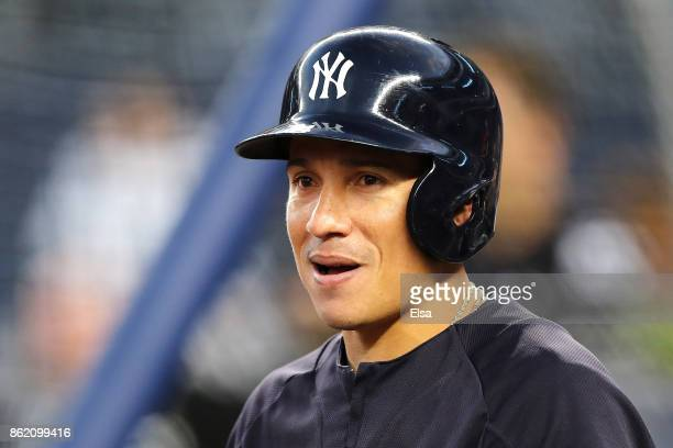 Ronald Torreyes of the New York Yankees looks on during batting practice before Game Three of the American League Championship Series against the...