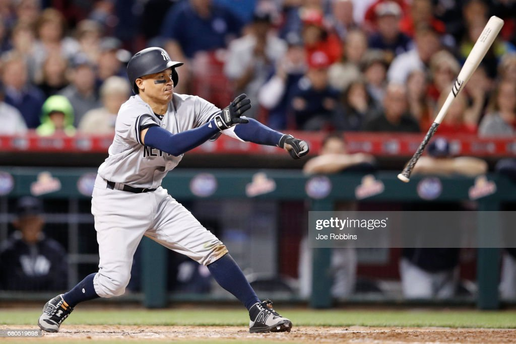 Ronald Torreyes #74 of the New York Yankees loses his bat while hitting against the Cincinnati Reds in the seventh inning of a game at Great American Ball Park on May 8, 2017 in Cincinnati, Ohio.
