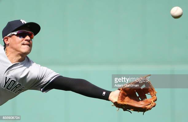 Ronald Torreyes of the New York Yankees reaches for a ball in the second inning of a game against the Boston Red Sox at Fenway Park on August 20 2017...