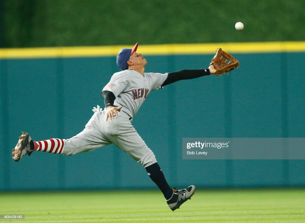 Ronald Torreyes #74 of the New York Yankees reaches for a popup by Jake Marisnick #6 of the Houston Astros in the third inning but was unable to make a play at Minute Maid Park on July 1, 2017 in Houston, Texas.