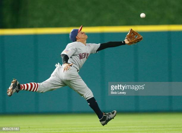 Ronald Torreyes of the New York Yankees reaches for a popup by Jake Marisnick of the Houston Astros in the third inning but was unable to make a play...