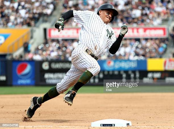 Ronald Torreyes of the New York Yankees rounds third and heads for home on a double from teammate Gary Sanchez in the seventh inning against the...