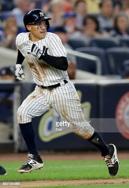 Ronald Torreyes of the New York Yankees scores off a single from teammate Aaron Hicks in the third inning against the New York Mets during...