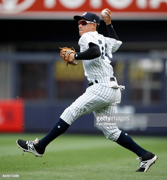 Ronald Torreyes of the New York Yankees throws the ball in from the outfield grass in an MLB baseball game against the Boston Red Sox on September 2...