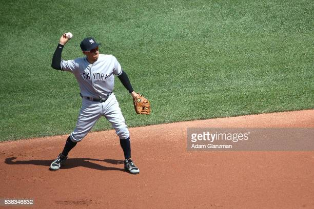 Ronald Torreyes of the New York Yankees throws to first base during a game against the Boston Red Sox at Fenway Park on August 20 2017 in Boston...