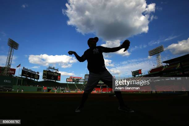 Ronald Torreyes of the New York Yankees warms up before a game against the Boston Red Sox at Fenway Park on August 19 2017 in Boston Massachusetts