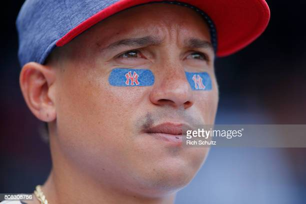 Ronald Torreyes of the New York Yankees wears Red White and Blue NY eye black during a game against the Toronto Blue Jays at Yankee Stadium on July 4...