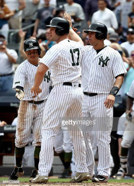 Ronald TorreyesGary Sanchez and Matt Holliday of the New York Yankees celebrate at home plate as they way for teammate Aaron Judge after Judge drove...