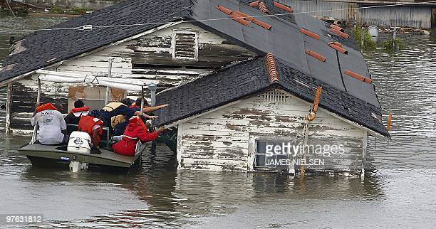 Ronald Wood is rescued from his home in New Orleans Louisiana after Hurricane Katrina made landfall near New Orleans Louisiana on Monday 29 August...