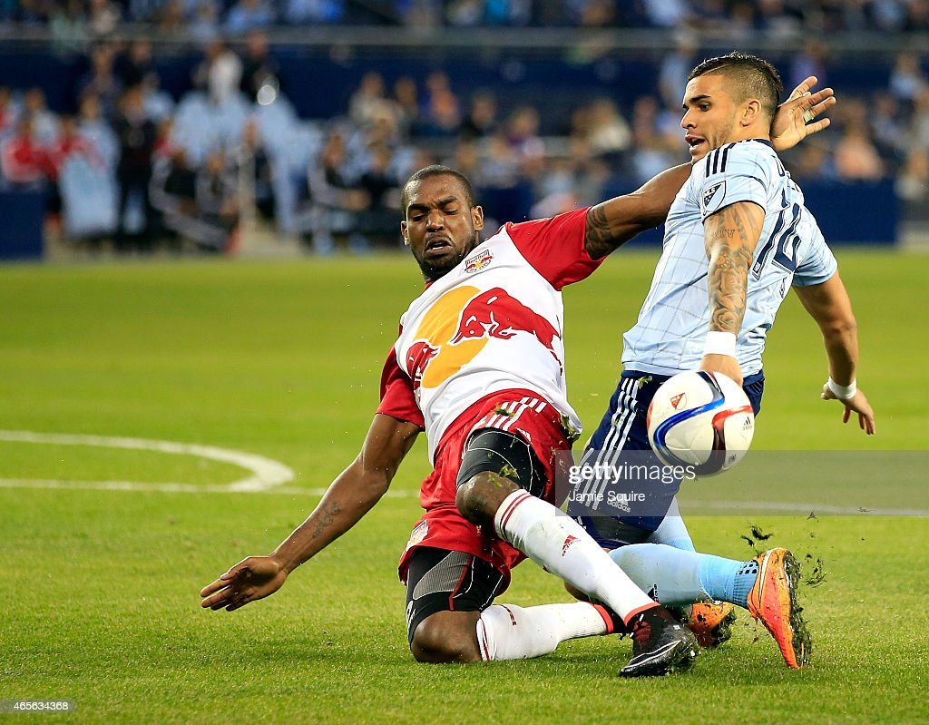 <a gi-track='captionPersonalityLinkClicked' href=/galleries/search?phrase=Ronald+Zubar&family=editorial&specificpeople=1295892 ng-click='$event.stopPropagation()'>Ronald Zubar</a> #23 of New York Red Bulls tackles Dom Dwyer #14 of Sporting KC during the game at Sporting Park on March 8, 2015 in Kansas City, Kansas.