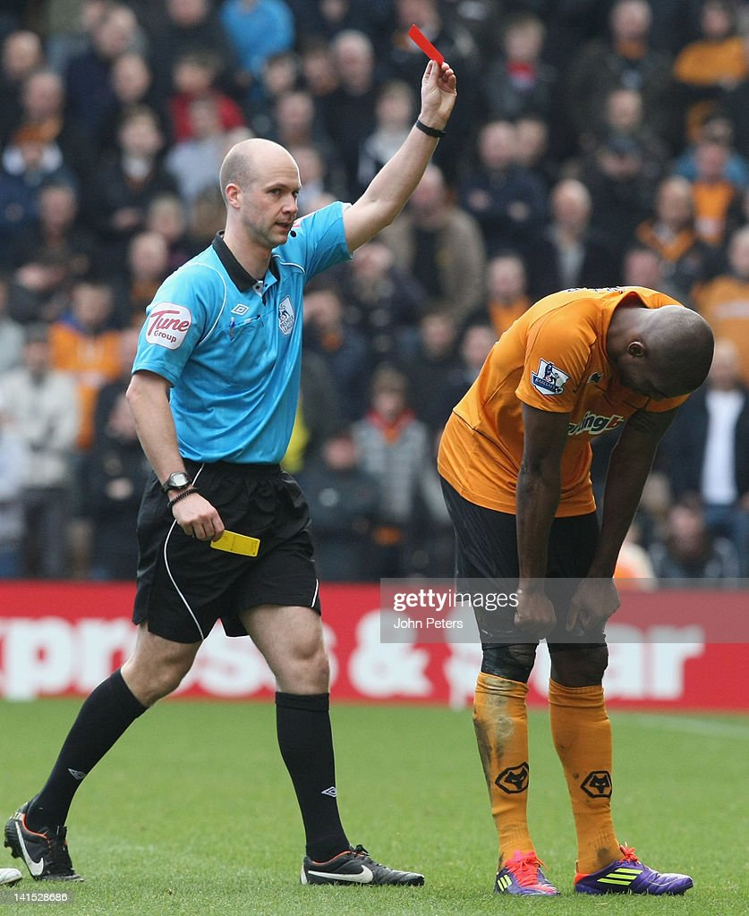 <a gi-track='captionPersonalityLinkClicked' href=/galleries/search?phrase=Ronald+Zubar&family=editorial&specificpeople=1295892 ng-click='$event.stopPropagation()'>Ronald Zubar</a> of Wolverhampton Wanderers is sent off by referee Anthony Taylor during the Barclays Premier League match between Wolverhampton Wanderers and Manchester United at Molineux on March 18, 2012 in Wolverhampton, England.