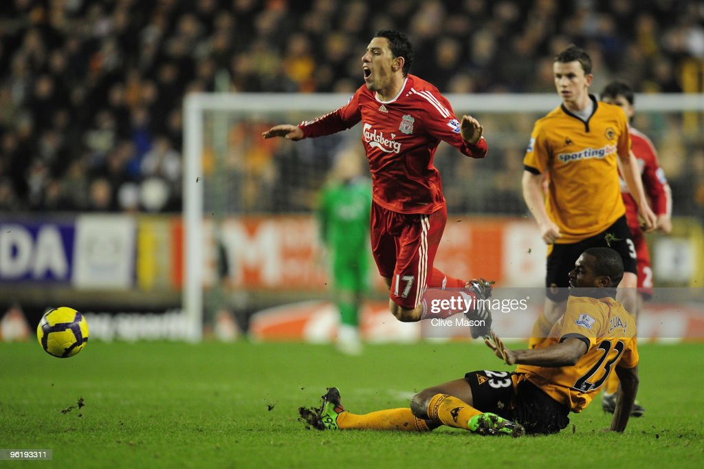 <a gi-track='captionPersonalityLinkClicked' href=/galleries/search?phrase=Ronald+Zubar&family=editorial&specificpeople=1295892 ng-click='$event.stopPropagation()'>Ronald Zubar</a> of Wolverhampton Wanderers tackles <a gi-track='captionPersonalityLinkClicked' href=/galleries/search?phrase=Maxi+Rodriguez&family=editorial&specificpeople=234431 ng-click='$event.stopPropagation()'>Maxi Rodriguez</a> of Liverpool during the Barclays Premier League match between Wolverhampton Wanderers and Liverpool at Molineux on January 26, 2010 in Wolverhampton, England.