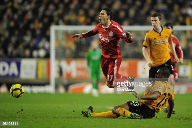 Ronald Zubar of Wolverhampton Wanderers tackles Maxi Rodriguez of Liverpool during the Barclays Premier League match between Wolverhampton Wanderers...