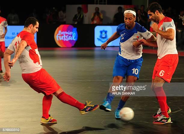 Ronaldhino from the Goa 5's plays against Kolkata 5's during their Premier Futsal Football League match in Chennai on July 15 2016 / AFP / ARUN SANKAR
