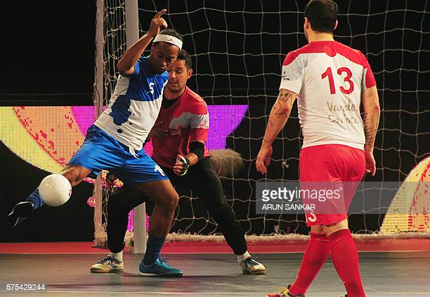 Ronaldhino from the Goa 5's plays against the Kolkata 5's during their Premier Futsal Football League match in Chennai on July 15 2016 / AFP / ARUN...